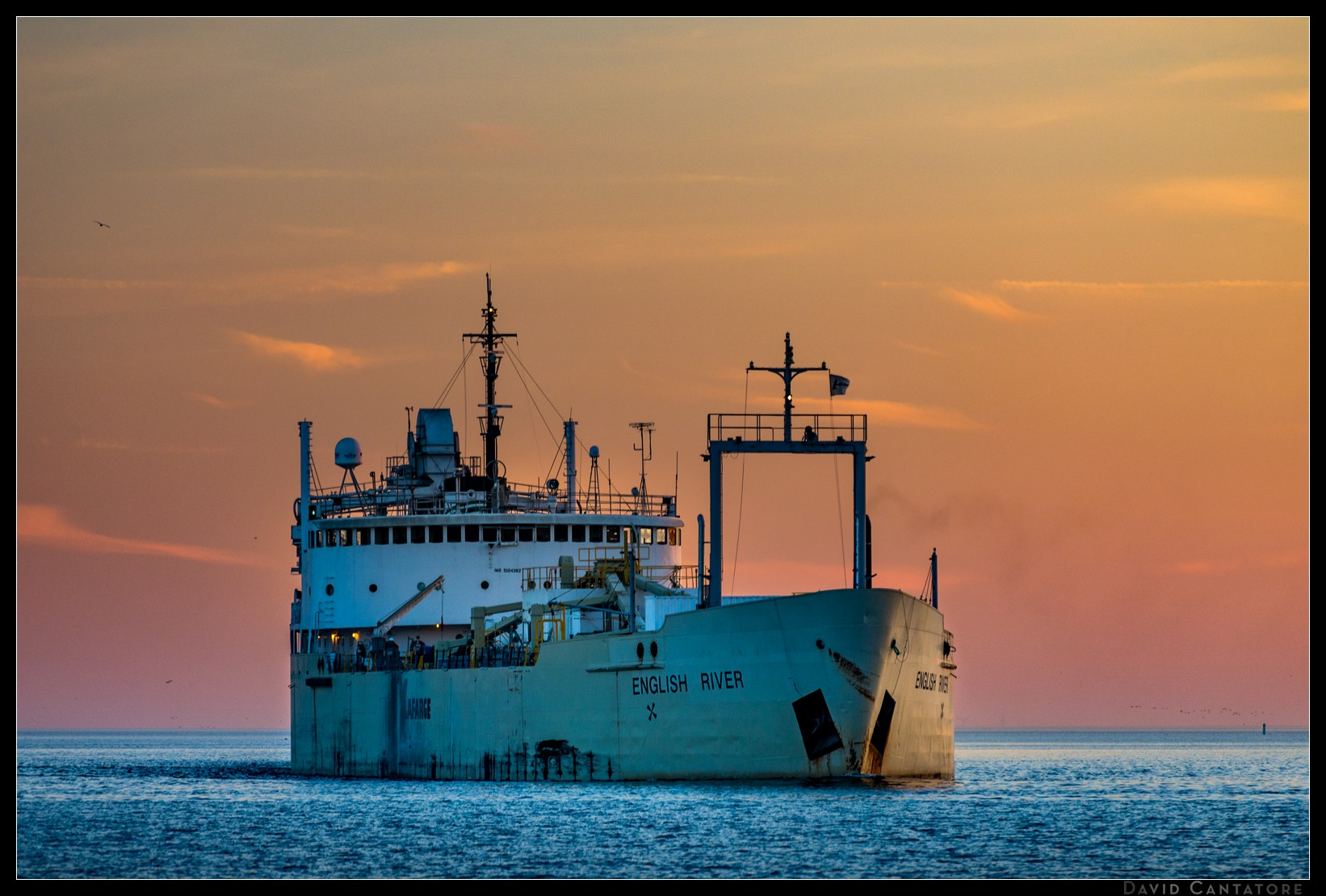 Freighter entering the Toronto harbour at sunset.